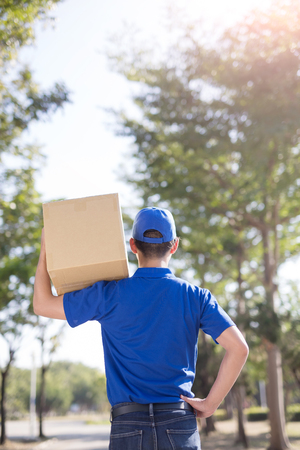 warehouseman: deliveryman stand and back to you, asian