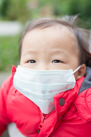 cute baby get cold wear mask,  asian
