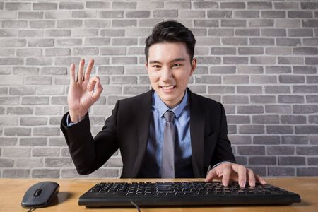 asian business man: business man use computer in the office, asian