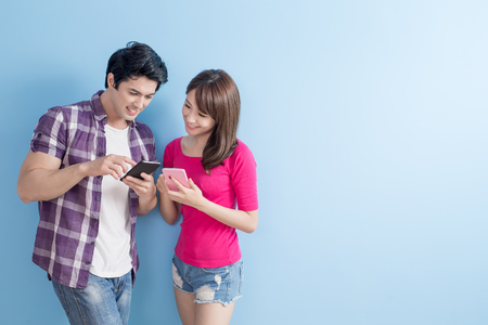 japanese people: young couple go to travel and use phone
