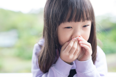 little girl get cold and blow her nose,  asian photo