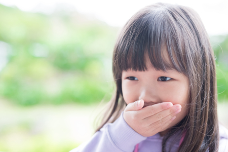 cute little girl get cold and feel vomit, asian photo