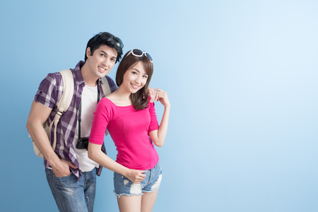 photo: young couple go to travel and smile happily