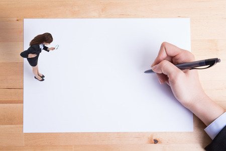 paper sheet: business woman uses magnifying and stand on paper with white paper