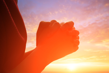 shalom: young woman pray pious with sunrise, asian