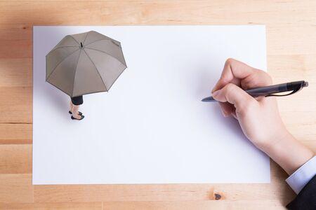 paper umbrella: business woman take umbrella and stand on white paper