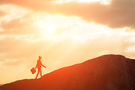 silhouette of business woman walk to the peak Stock Photo