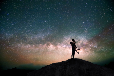 stars: silhouette of couple with night scene milky way background in the galaxy Stock Photo