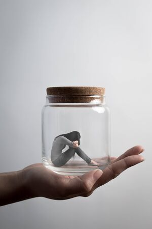 proble: the depression woman sit imprisoned in jar