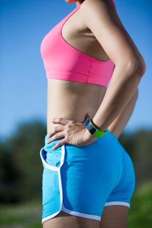 health sport woman wearing smart watch device with touchscreen doing exercises Stock Photo