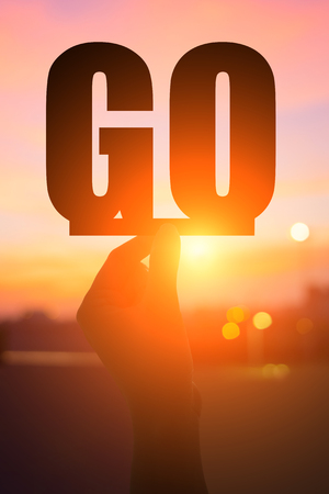 silhouette of hand take go word with sunshine Stock Photo