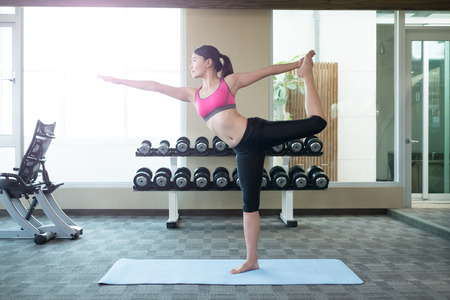healthy body: beauty sport woman smile and do yoga in the gym