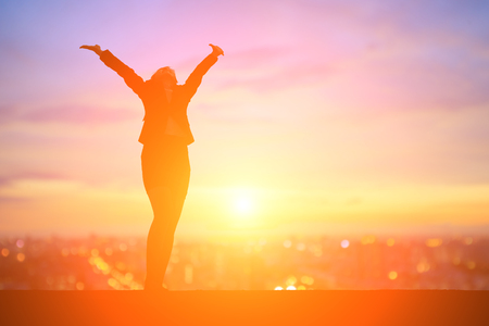 silhouette of business woman feel free with sunset Stock Photo