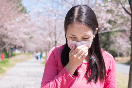 woman feel pain and wear mask with hay fever