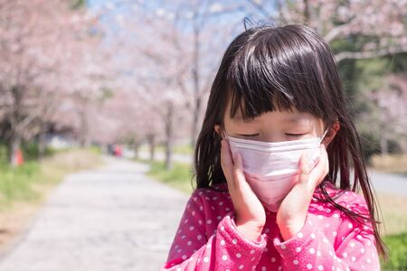 little girl wear mask with hay fever Stock Photo