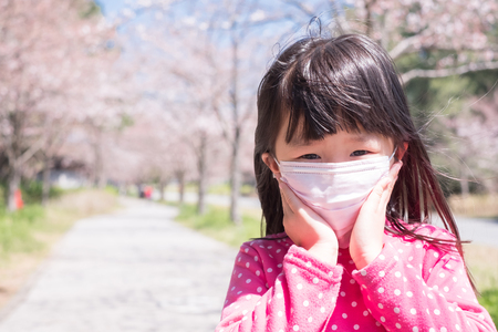 handkerchief: little girl wear mask with hay fever Stock Photo
