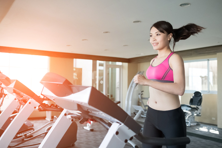 woman run on treadmill in the gym Stock Photo