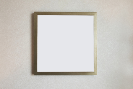 scratches: picture frame isolated on white wall in museum