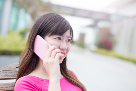 touchscreen: woman talk on phone happily in the park