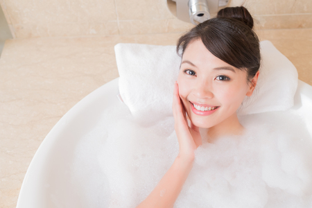 beauty woman relax and take bath in the bathroom 免版税图像