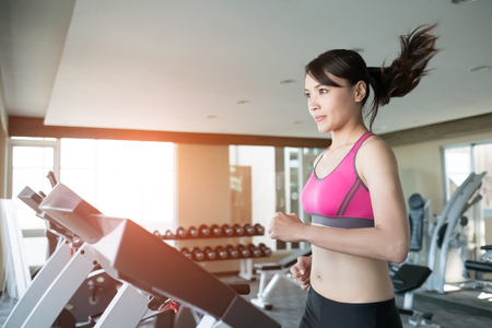 close up: woman run on treadmill in the gym Stock Photo