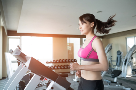 woman run on treadmill in the gym Stock Photo