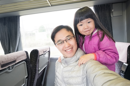buss: father and daughter selfie happily in the bus