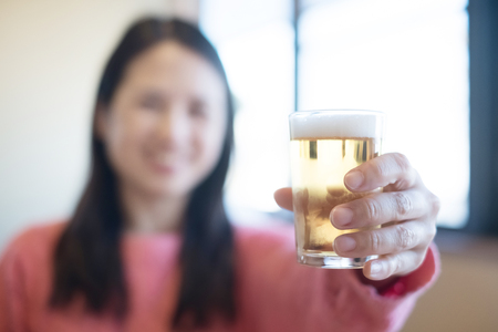 Middle aged women smile happily with beer photo