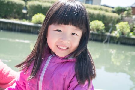 cute little girl smile happily to you