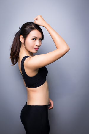 healthy body: beauty sport woman on the gray background
