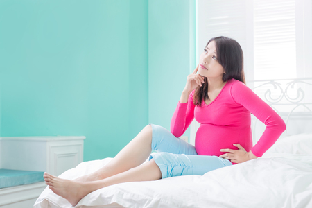 beauty pregnancy woman feel upset on the bed