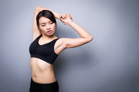 beauty sport woman on the gray background