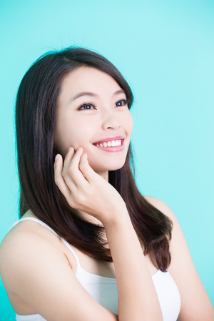 beauty skincare woman smile happily and look somewhere on green background