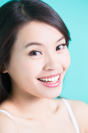 salon: beauty skincare woman with healthy tooth on green background Stock Photo