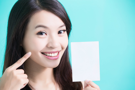 beauty skincare woman take picture and point her face Stock Photo