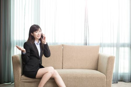 couch: business woman smile happily and talk on phone Stock Photo