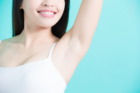 beauty woman smile happily with body odor problem Stockfoto