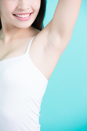 intolerable: beauty woman smile happily with body odor problem Stock Photo