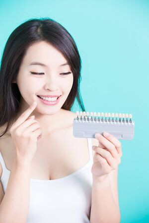 woman take tooth color palette with whiten concept Stock Photo