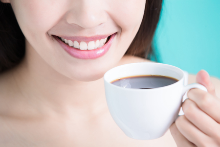 close up: woman take cafe on the green background Stock Photo