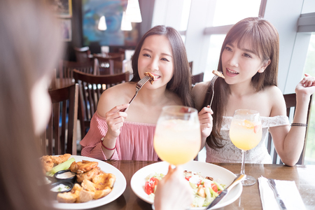 dine: beauty women smile and dine in restaurant