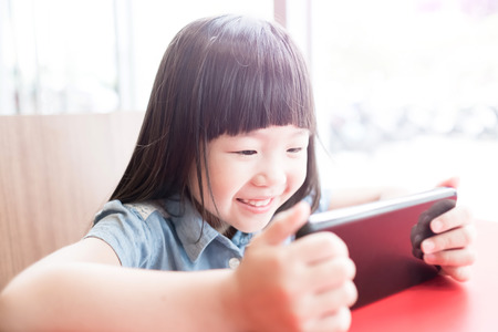 screen: cute girl use phone in the resturant