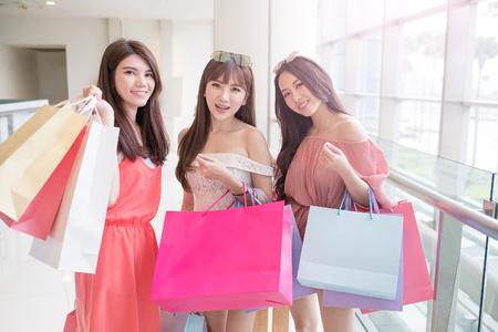 customer: beauty women take shopping bag and smile happily in mall