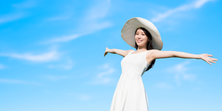 happy holidays: beauty travle woman feel free with blue sky