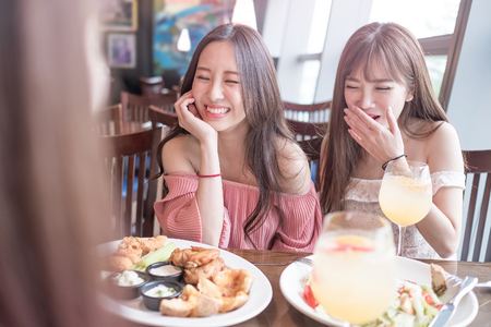 beauty women smile and dine in restaurant