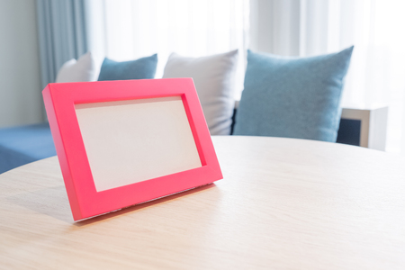 forme: close up photo frame on table in the home