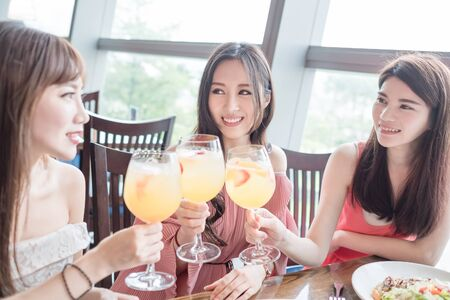 thrilled: beauty women smile and dine in restaurant