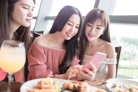 beauty women use phone and dine in restaurant photo