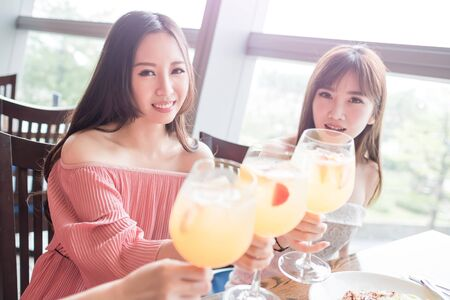 beauty women smile and dine in restaurant photo