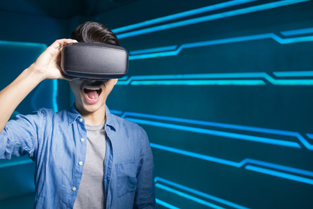 project: man wear vr on the technology background